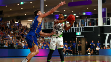 Blockage: South East Melbourne's Jon Roberson tries to find a way around Bullets' Will Magnus.