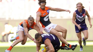 Sean Darcy of the Dockers contests for the ball against Nick Haynes and Callan Ward.