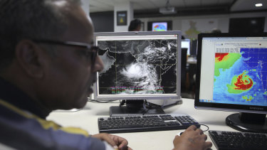 A staffer monitors cCyclone Vayu at the Indian Meteorological Department office in Delhi, India.