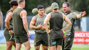 Dave Rennie (right) addresses his players, including Hunter Paisami, in Cessnock.