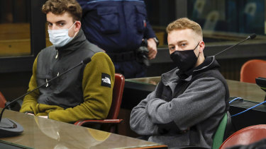 Gabriel Natale-Hjorth, from the US, left, and his co-defendant Finnegan Lee Elder sit during a break of a hearing in Rome.