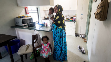 Duretti Garada and two of her children, 18-month-old Haliima and four-month-old Yaaquub, in their apartment, which is next to construction works.