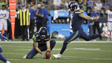 Impact: Seattle's Jason Myers kicks a field goal as punter Michael Dickson holds the ball.
