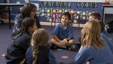 Woollahra Public School students with principal Nicole Molloy.