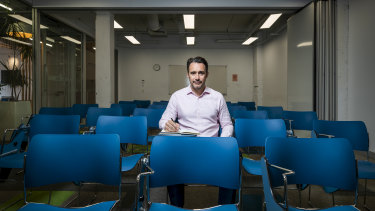 Ben Bonjean, director of English First's Australia operations, sits in an empty classroom at the company's Sydney college, which has six students.