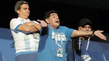Argentine legend Diego Maradona waves to fans ahead of the match.