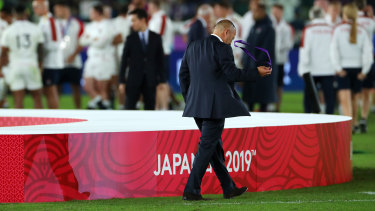 Bitter end: Eddie Jones removes his runners-up medal as he walks away from the podium dejected. A number of England players did likewise.