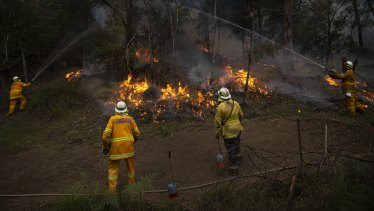 NSW RFS Crews conducting a backburn on the Gospers Mountain Fire at Colo last week.