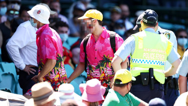 Police deal with spectators at the SCG during a controversial Test against India.