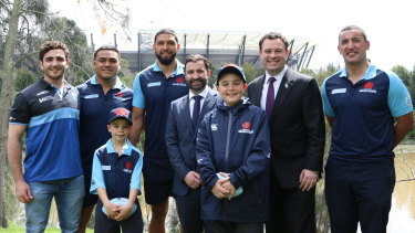 Go west, young men: Parramatta's Ken Catchpole Medalist Adrian Musico, Waratahs prop Shambeckler Vui, centre Curtis Rona, NSW Rugby Union boss Andrew Hore, NSW Minister for Sport Stuart Ayres and Waratahs coach Daryl Gibson with Waratahs supporters Lincoln, 11, and Hayden Milson, 8.