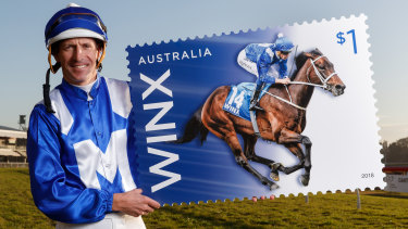 Stamp it: Jockey Hugh Bowman shows off the Winx stamp