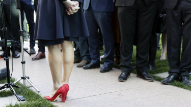 The contrast of Julie Bishop's red shoes against a sea of black footwear spoke to the Liberal Party's issues with female representation.