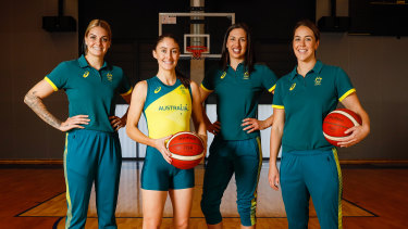 Cayla George, Katie Ebzery, Marianna Tolo and Jenna O'Hea pose during the Australian women's basketball squad announcement on Wednesday.