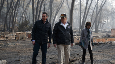 President Donald Trump talks with California Governor-elect Gavin Newsom and Paradise Mayor Jody Jones during a visit to a neighbourhood destroyed by the wildfires, on Saturday.