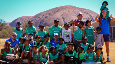 Young Indigenous kids try their hand at rugby at Uluru.