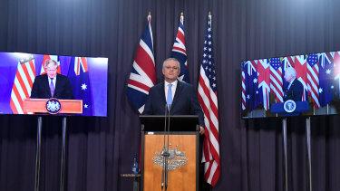 Prime ministers Boris Johnson and Scott Morrison, with US President Joe Biden, announce the AUKUS pact.