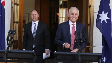 Prime Minister Malcolm Turnbull and Energy Minister Josh Frydenberg address the media after the party room win on Tuesday.