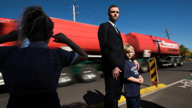 Nikolas Brudenell and his two children are awoken nearly every night, as nearly 700 trucks rattle past their home daily on Hyde Street, due to West Gate Tunnel pre-construction works.