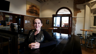 "Michelle McCarthy manages the Grand Hotel Kiama, which relies on its budget rooms and its pub to attract guests. She says Airbnb ""eats into the tourism dollar""."