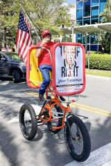 A Trump supporter on a tricycle at the Conservative Political Action Conference (CPAC) in Orlando, Florida.