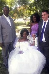 Zanele Ndlovu and Jamie Fox hold hands on their wedding day at a hospital Chapel in Bulawayo, Zimbabwe.