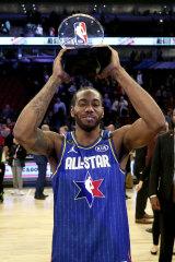 Kawhi Leonard with the Kobe Bryant MVP award after the 69th NBA All-Star Game.