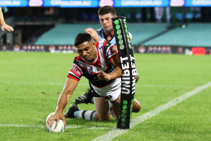 Daniel Tupou beats the tackle of Chad Townsend to score for the Roosters.