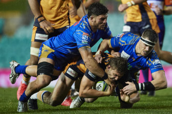Brumbies back Bayley Kuenzle is tackled in a match against the Western Force last year.