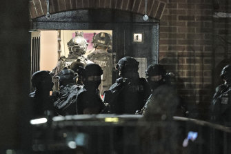 Armed police officers investigate at a block of flats off the Basingstoke Road in Reading after an incident at Forbury Gardens park in the town centre of Reading, England.
