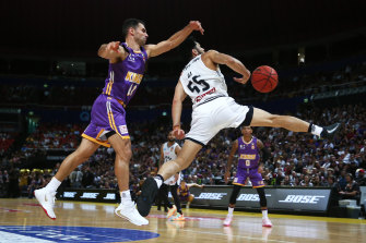 Kings captain Kevin Lisch and Shea Ili of Melbourne United.