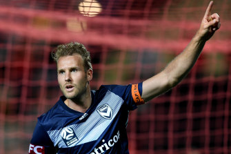Victory's Ola Toivonen celebrates after scoring Melbourne's first goal against Adelaide.