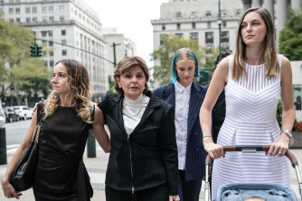 Gloria Allred, representing several of Jeffrey Epstein's alleged victims, second left, arrives at court.