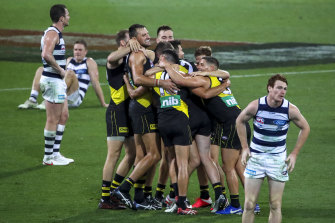 To the victors go the spoils: Richmond celebrate victory in the 2020 grand final over the Cats.