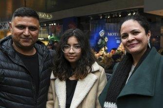 Amarjeet Sharma, right, of Mount Waverley, in Bourke Street Mall with husband, Vishal Sharma, and daughter Kheyaira.