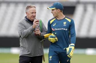 Ian Healy, left, with Tim Paine during last year's Ashes series in England.