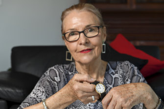 Jan McDonald with a watch she gave to her son, Guy Wettenhall, who was murdered in 1992.