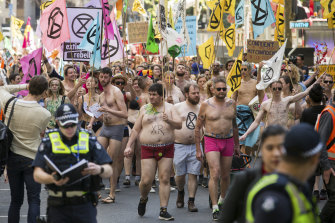Spring rebellion: Activists stripped to their underwear and marched through the streets of Melboune last weekend.