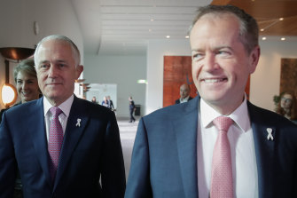 White Ribbon drew support from prominent leaders. Then-Prime Minister Malcolm Turnbull and Opposition Leader Bill Shorten at a White Ribbon breakfast in 2017.