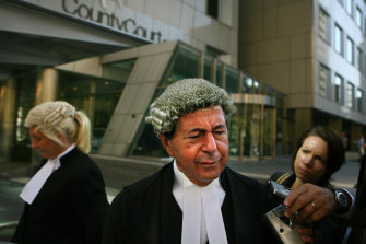 Con Heliotis talks to the media in March 2006 after Mokbel, his client, failed to show up to court. Ms Gobbo is pictured in the background.