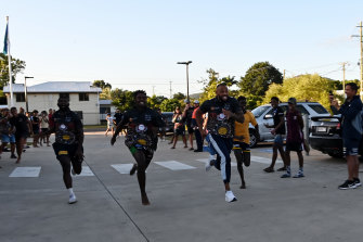 Josh Addo-Carr races a few kids living at Cowboys House.