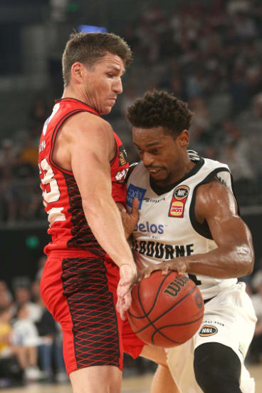 Casper Ware of Melbourne, right, battles Damian Martin of Perth.