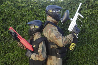 A child with a MiniBall gun versus an adult with a Paintball Gun at Delta Force Paintball in Appin.