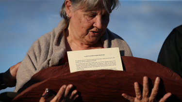 Pat Anderson from the Referendum Council with a piti holding the Uluru Statement from the Heart.