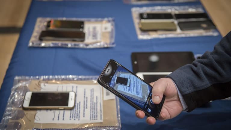 Encrypted smartphones held as evidence by the New York City Police Department on display in 2016.
