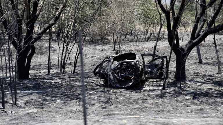 A burnt-out car in Kabra.