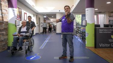 Musical reception: volunteer Jozsef Tallosi plays in the Footscray hospital foyer.