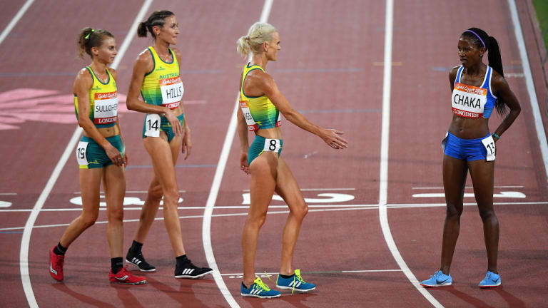 Celia Sullohern, Madeline Hills, Eloise Wellings of Australia congratulate Lineo Chaka of Lesotho after Chaka came last  in the Women's 10,000m final.