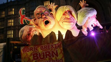 """Burn Brexit Burn"": Anti-Brexit protesters show effigies of Michael Gove, Boris Johnson and Theresa May."