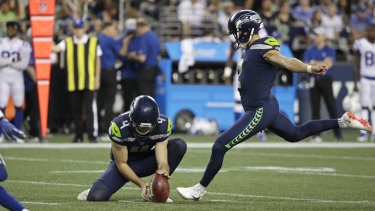 Michael Dickson holds the ball for Seattle field goal kicker Jason Myers during the pre-season.