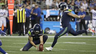 Making his mark: Michael Dickson holds the ball for Seahawks field goal kicker Jason Myers during the pre-season.